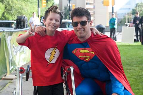 Drop Zone Participant as Superman and Easter Seals Kid