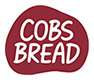 Corporate logo for Cobs Bread, featuring a deep burgundy coloured shape of a bread roll
